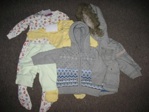 A 12 month sleep suit which was 50p, a 0-3 month old sleep suit for 1.50, 3 month leggings at 50p, a hooded top (0-3 months) at 75p, and a 3-6 month coat at 1.50 from a charity shop. Kindly bought by my mum.