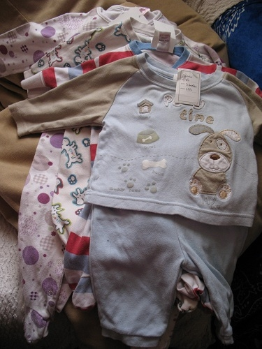 Top and trousers (3-6 months) at 1.95, stripey sleep suit (up to 1 month) at 50p, sleep suit (up to 1 month) at 50p, sleep suit (9-12 months) at 75p all from charity shops.