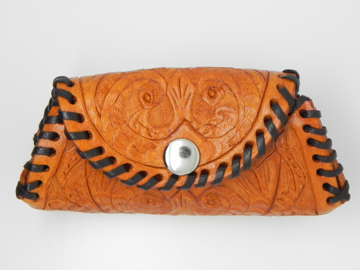 The completed carved leather gusset coin purse with its intricate design.