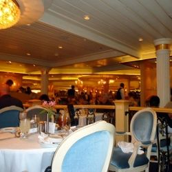 A view from a corner of one of the three levels in the main dinig room on a Freedom Class cruise ship.