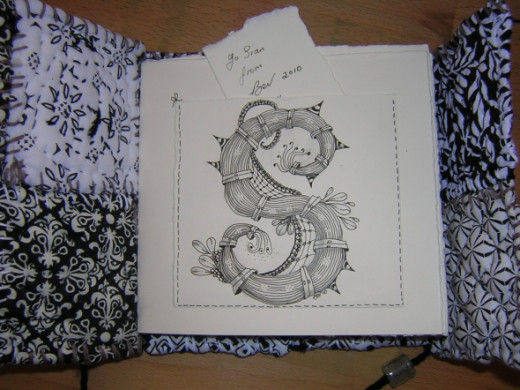 Yep, her name begins with 'S' so I added a Zentangle pocket to the first page.