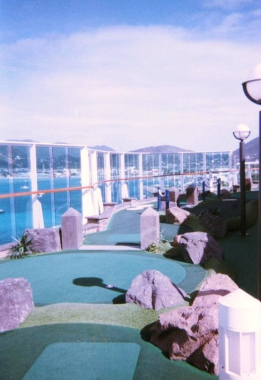 Mini golf at sea.  A view of part of the nine hole course on the Serenade of the Seas, one of Royal Caribbean's Radiance class ships