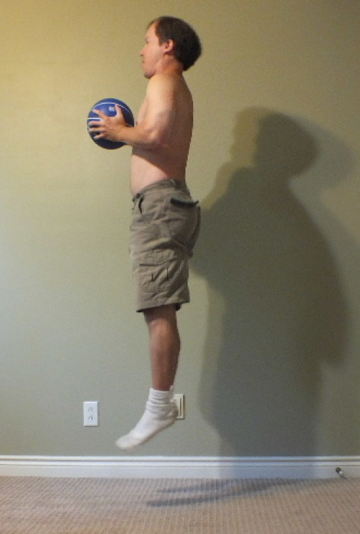 Jump squats with a medicine ball.