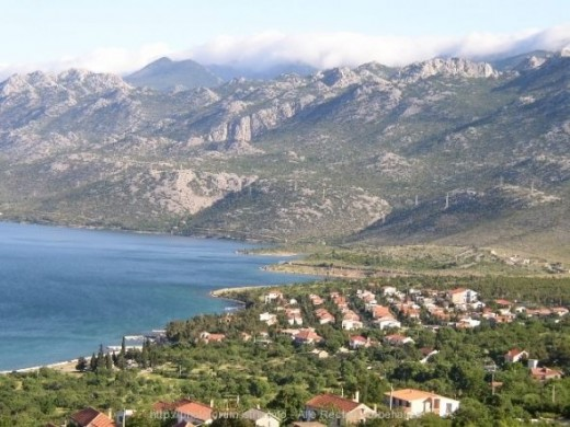 Starigrad - a tourist destination on coast of Adriatic sea is in front part of picture. You can see clouds stuck on mountain peaks!