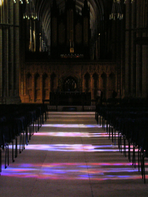 Photo of Lincoln Cathedral nave taken with my Nikon digital camera in 2005. Stained glass produces beautiful lighting effects on the floor.