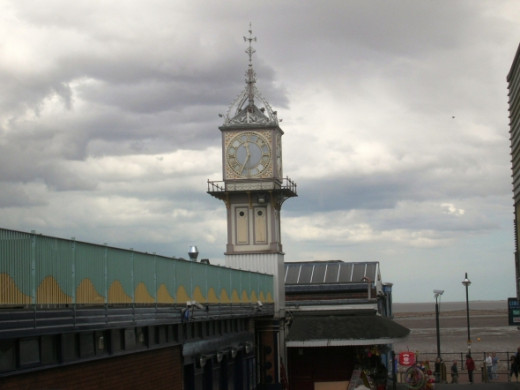 View of the Victorian clock tower from the top of the ramp by the station. You can see just how close the line is to the seafront. This line is a terminal and trains come in from Grimsby, just down the line.