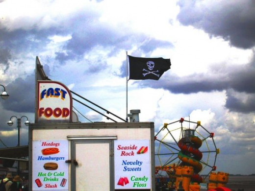 And on the beach itself there are the amusements for little children. (More later!) I loved the way the Jolly Roger appeared to fly dramatically over this fast food stall. Really it belonged to the pirate ship ride the other side!