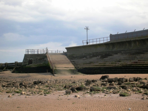 Here you can see where the beach ends and the sea defenses begin. The wall carries on from where I was standing to protect the terraced houses near the Blundell Park stadium from another great flood.
