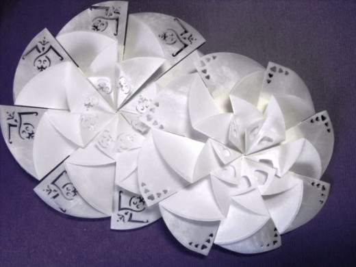 Fold as above and glue on a circle.