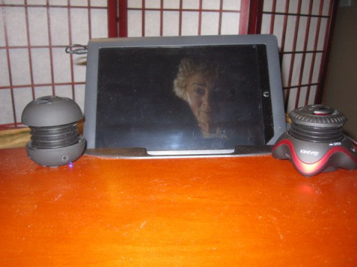 I have the option to use the slot at the back of the desk for my Nook, when I choose to stream movies in bed.