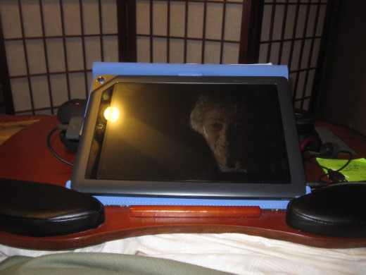 If I don't want to take the Nook out of the cover, then I prop it up steeple fashion on the lap desk, when I choose to stream movies in bed.