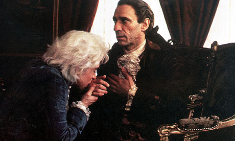 "Mozart (Tom Hulce) kissing the hand of Salieri (F. Murray Abraham). ""It's not a holy relic!"""