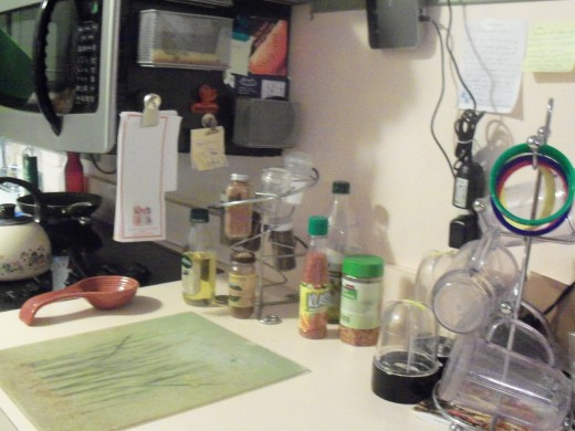 Various spices sitting on the kitchen counter