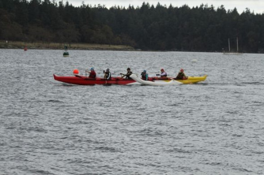 A crew is seen crossing the finish line at the end of a 1000 meter heat. (Battle of the Bay, Nanaimo, BC, Oct 22, 2011)