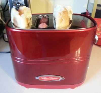 Hot dogs and buns in the toaster