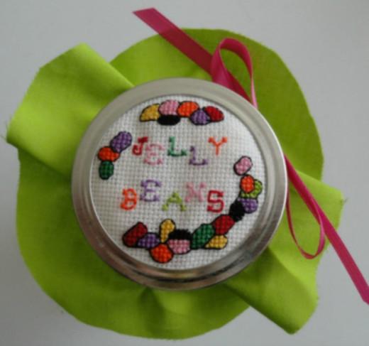 Glue ribbon to the jar lid.