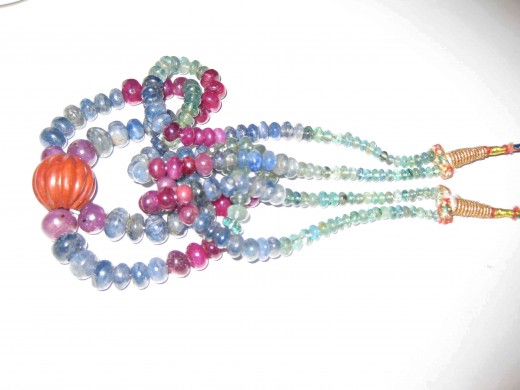 Seni precious beads are mixed and capitulated to form designed string