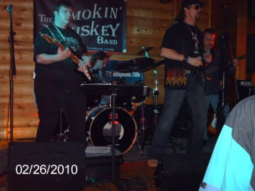 One of the guitarists, my husband the drummer, and the singer.