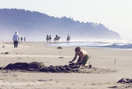 Sand Play and Horseback Riding on the Beach