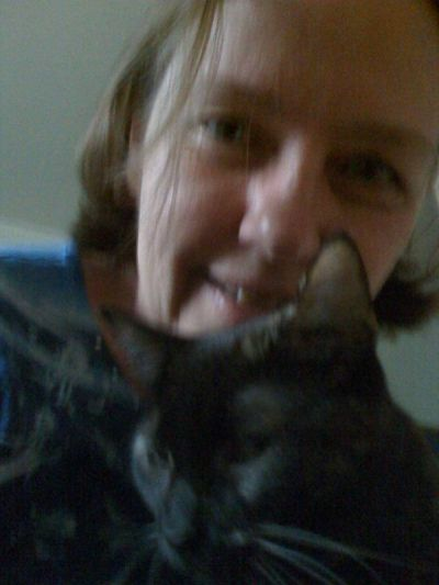 I love cats. This is a photo of me with our cat Sunshine.