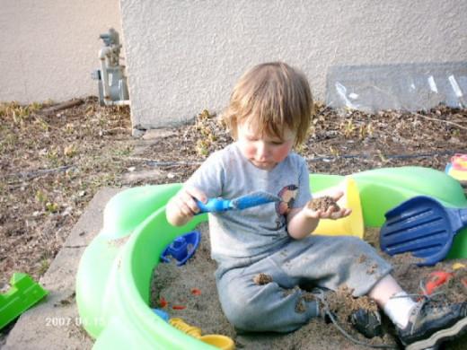 Ben playing in his sandbox.