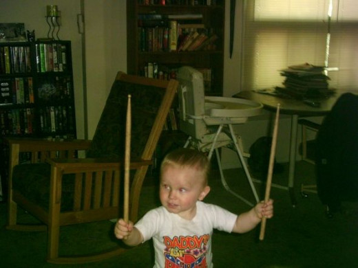 Playing drums like his daddy.