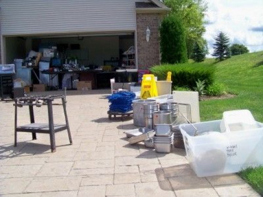 Beginning to set items for the garage sale in the driveway closer to the road