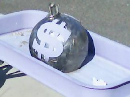 Sculpture of Bag of Money in a wagon