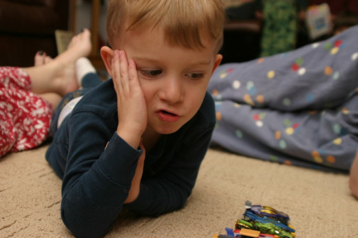 This little boy is learning math as he plays with his matchbox cars... Used under creative commons