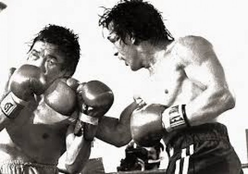 "Ray ""Boom Boom"" Mancini defended his lightweight tile by stopping Duek-Koo Kim in the 14th round."