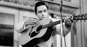 Johnny Cash tuning his guitar