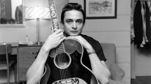 young Johnny Cash and his guitar