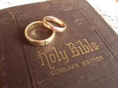 the Bible with wedding rings