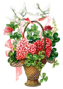 Doves carrying a basket filled with symbols of good luck and love.