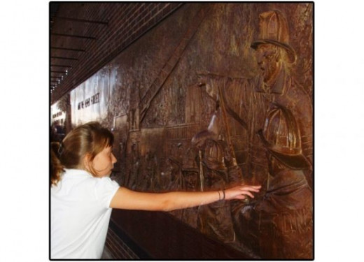 My daughter touching the memorial wall.