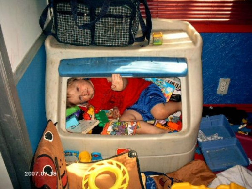Ben in his toy box.