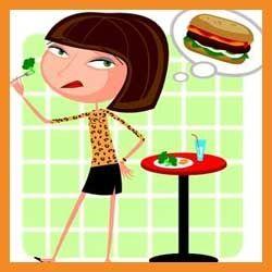 Woman dreams of hamburgers while eating salad.