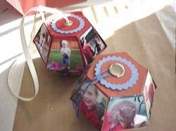 Two hanging photo-cubes decorated for Christmas
