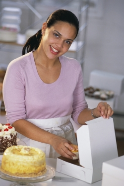 Woman Opening Cake Package