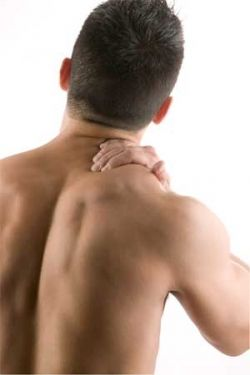 Man Rubbing his Aching Shoulder
