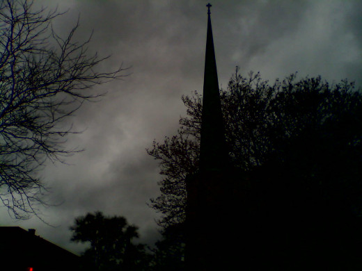 A church steeple in Evanston during a storm.