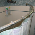 Install a Curved Shower Curtain Rod to Instantly Create More Space in the Shower