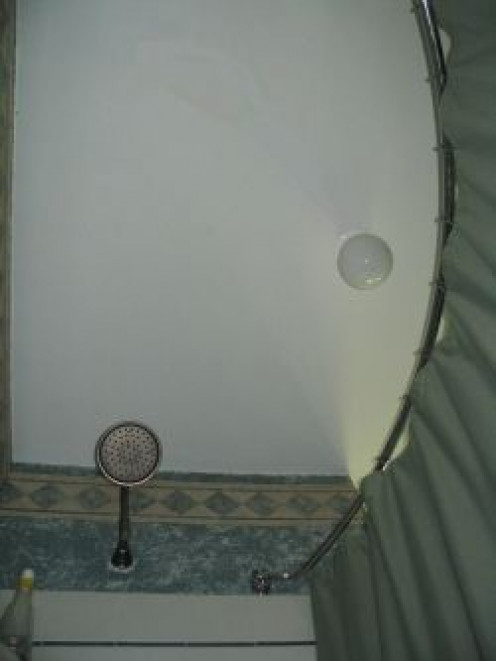 The curved shower curtain rod increases space in the shower