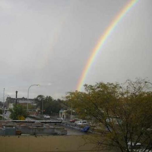 A double rainbow after a hard rain.