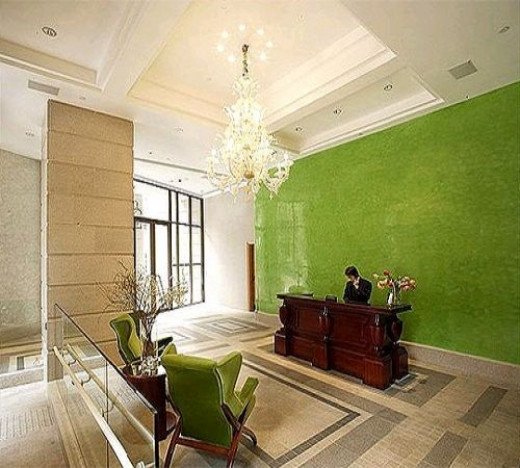 This is another great example of how effective a little bright color can be when used to define a space.  In this case, a little lime green is used to define the very large mostly-neutral space of the lobby of the Lanson Place Hotel in Hong Kong.  Sp