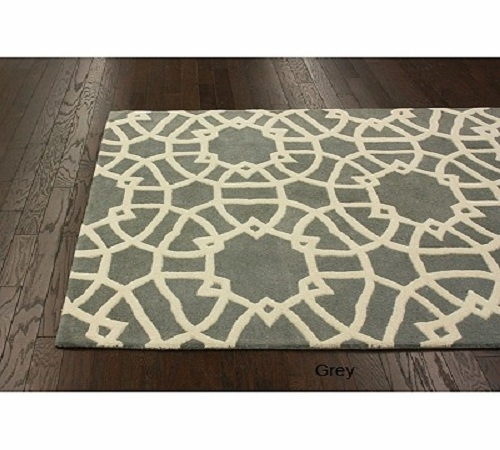 Art Deco-inspired wool area rug in a geometric fretwork design.  Much of Art Deco design makes use of geometric shapes and silhouettes for visual interest.  Pair it with a gray flannel sofa, a couple of sleek, cream side chairs, and a brushed steel c