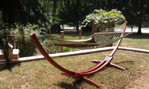 Wooden hammock with a stand