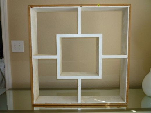 I paid $5 at a garage sale for this large-scale shadowbox.  The seller told me it came from a South Venice, FL teardown, where it was used as an indoor 'window' in a wall separating two rooms.  After I sanded down the rough spots, I oil-primed it, th