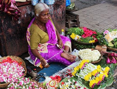 This granny uses the traditional method of stringing flowers with the help of her toes - From Mumbai Magic