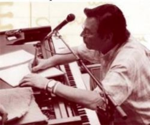 young Tom Jobim with piano